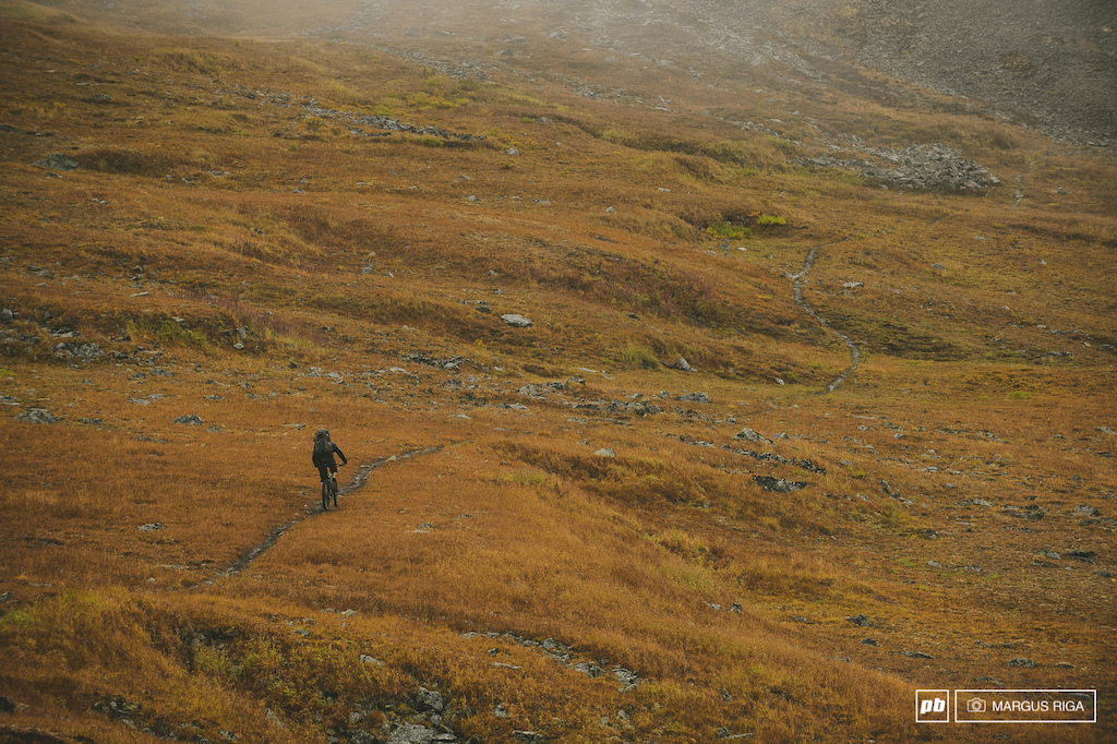 This shot was taken on our way back from a two-day ride hike-a-bike in the remote Tombstone range Yukon. James Doerfling and Kenny Smith were also part of our group but they were about ten minutes ahead. It was raining and the temps were near zero. Stopping to take a photo was the last thing on anyone s mind. Riley McIntosh suffering out one more photo before yet another life-draining hike-a-bike section before the final descent to our vehicle and dry clothes.