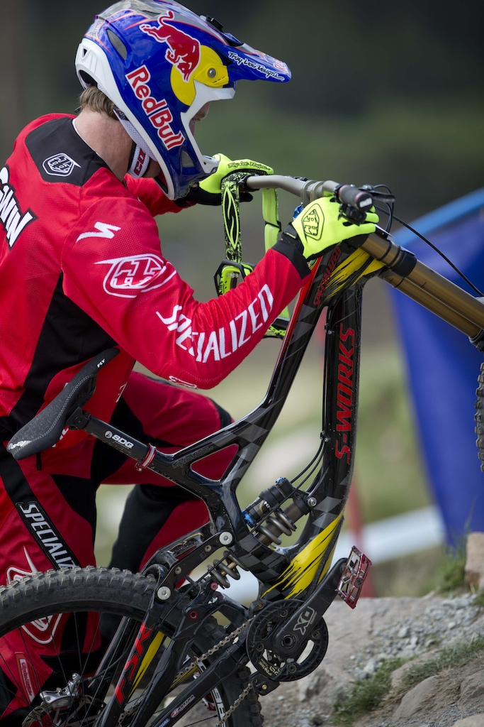 Aaron Gwin pushing back up the track to scope out some lines.