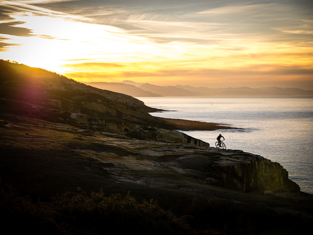 Riding on the Orbea Occam 29er on the Basque Coast at sunset. There is something really special about riding your bike by yourself on this wild coastline as the sun slowly sinks below the horizon. After this photo I packed the camera away put on my head light and ride for about an hour along the coast back to where my van was. Happy days