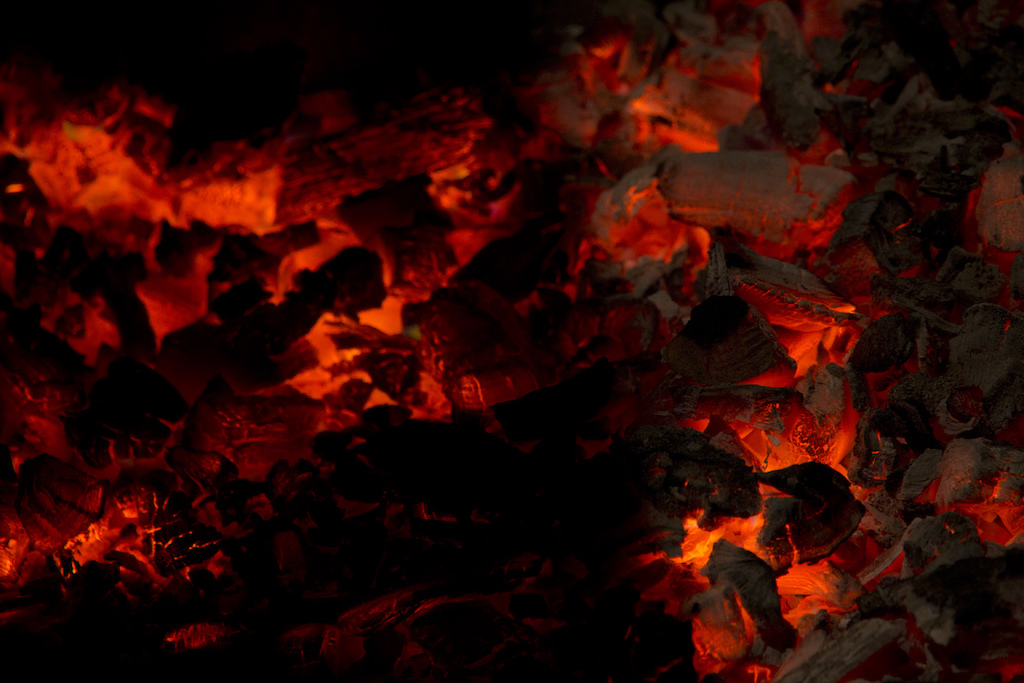 Eating outside means you can have mean coals to cook your food. Mike Hopkins Photo