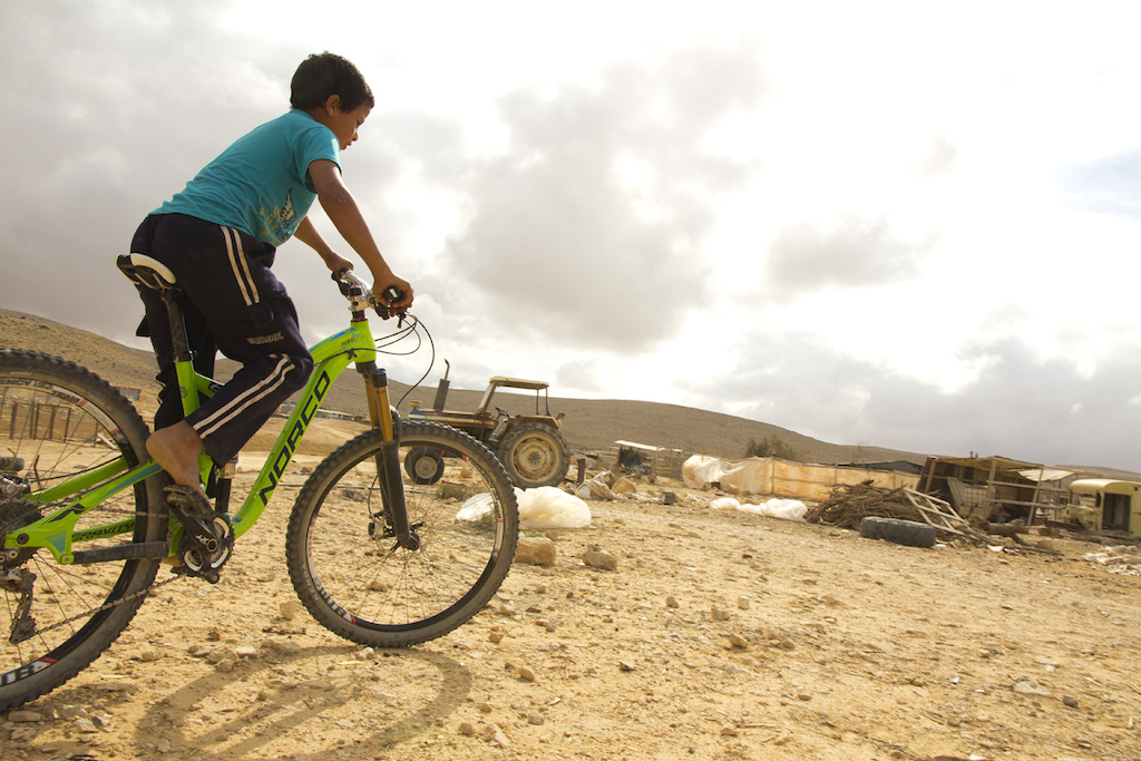Biking is our religion Nimi Cohen s mantra rang through again here. Bare feet huge bike don t care. Mike Hopkins photo.
