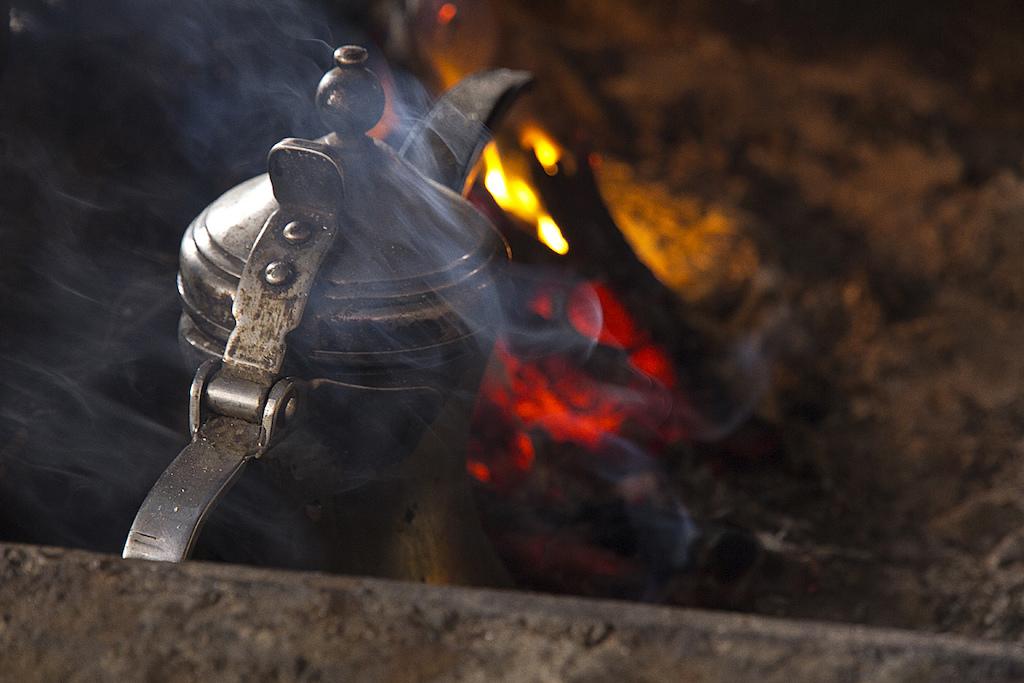 The Tea is brewed over open coals.