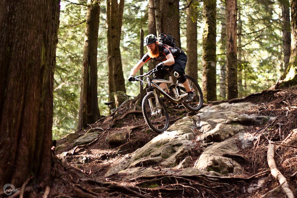 Morgan Taylor loves mountain biking with a beard. Photo courtesty of Cam McRae NSMB.com