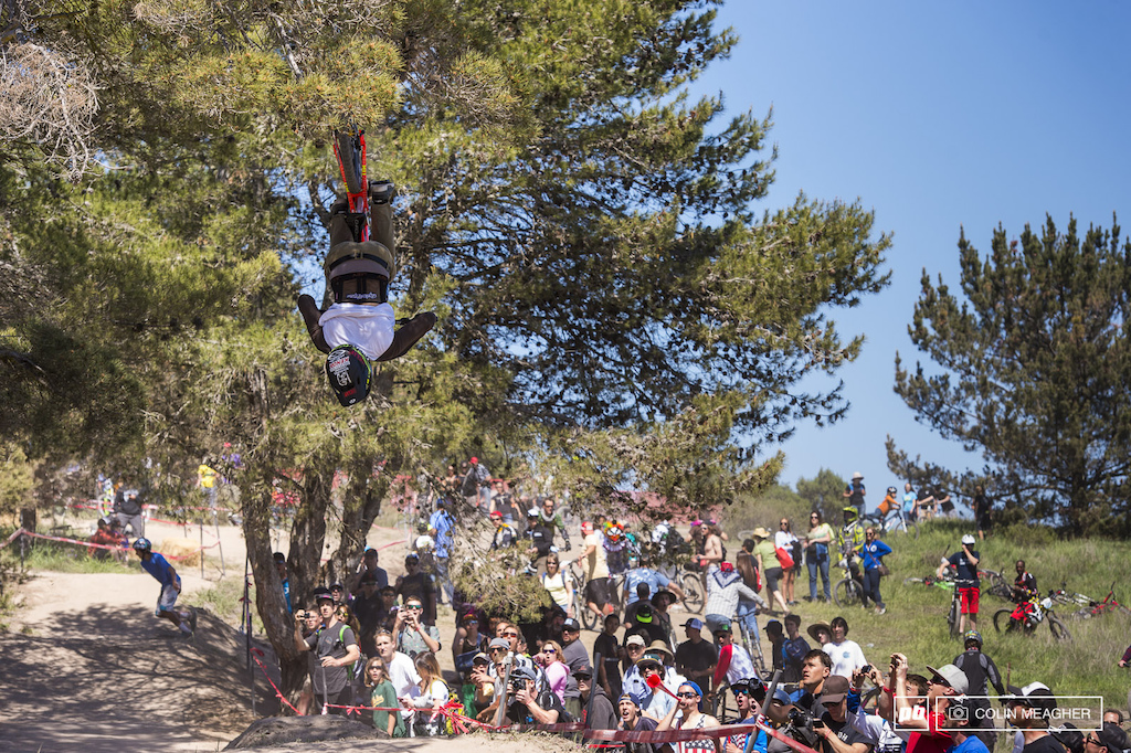 Carson Storch getting upside down during his race run in the men s Cat 1 DH field at Sea Otter.