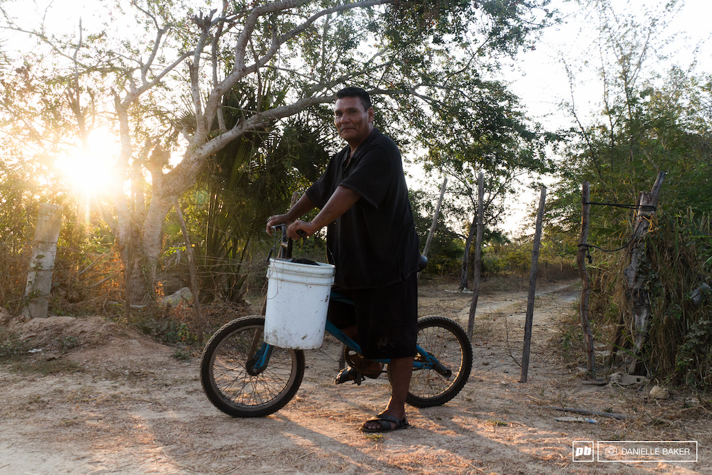 Antonio was spending his morning hauling buckets of dirt from the Noni pantation on his BMX ride.