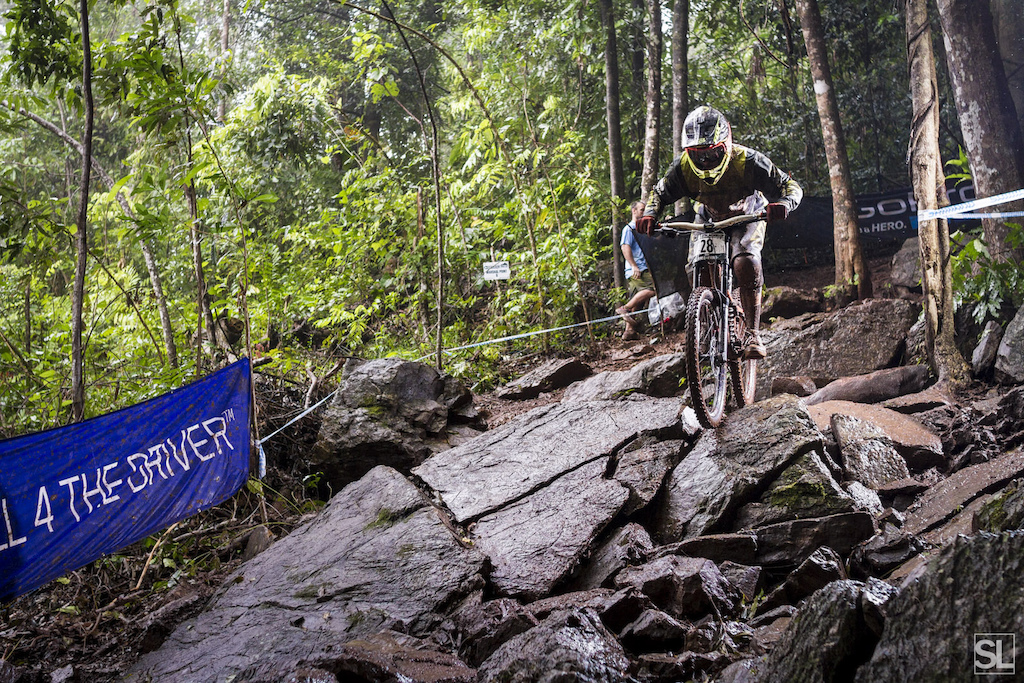 This rock garden only got slipperier as the day went on with hundreds of tyres shedding the greasy mud onto the conveniently smooth and off-cambered rock faces.