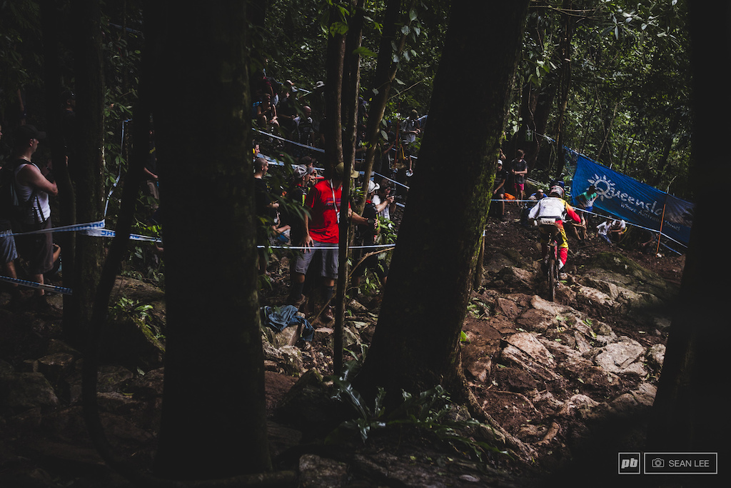 AUSSIE Dave McMillan battling the now-infamous rock garden that took out most if not all riders at one point this week. Greasy mud slick rocks and come race day hundreds of spectators and their respective decibels made it one of the most difficult and dangerous parts of the track.
