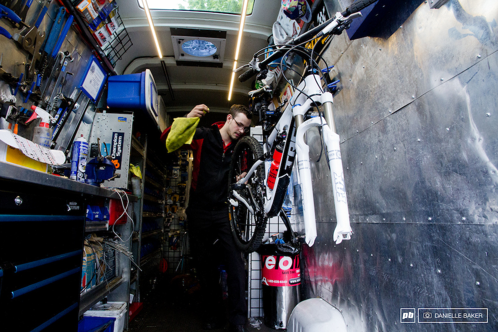 A bike rack near the front of the Sprinter van often houses bikes that require work so that the mechanics always have something to work on between house calls.