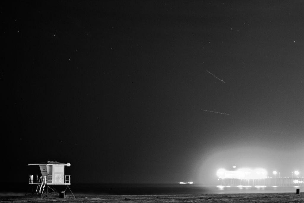 Huntington Beach and Pair looking sweet at night in black & white.