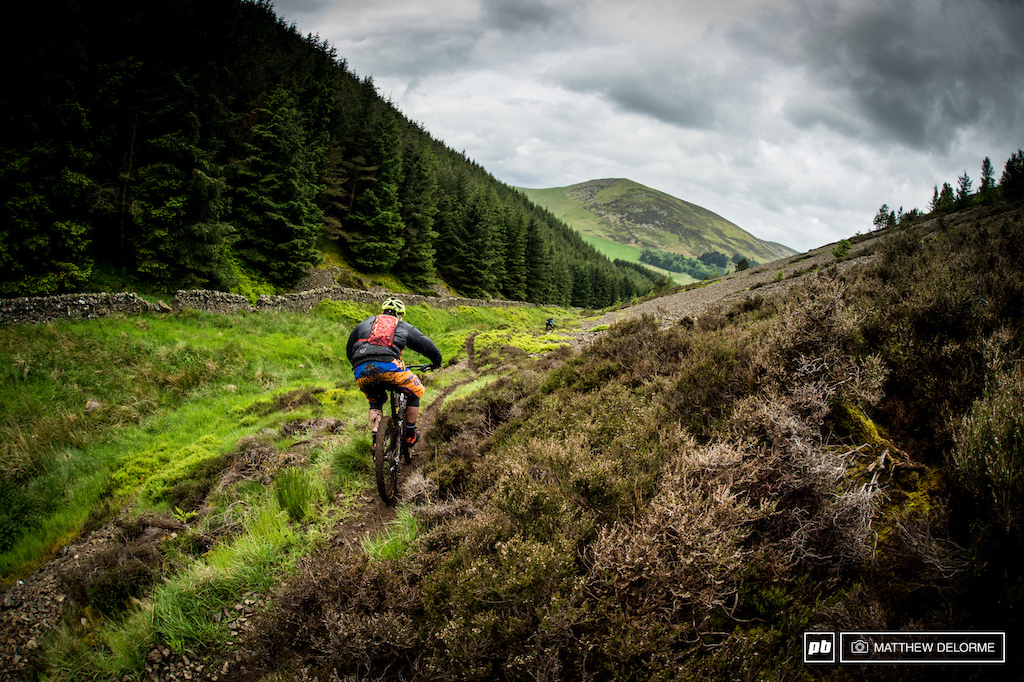 Day one kicks off on the network of trails the locals refer to as Golfy. The liaisons here are long dirt road climbs that run up to the top of Kirnie Law. Stages 1 and 2 then run through open heather fields before plunging into steep tight single track riddled with slick roots. Stay on with as little dabbing as possible and you ll be in good shape.
