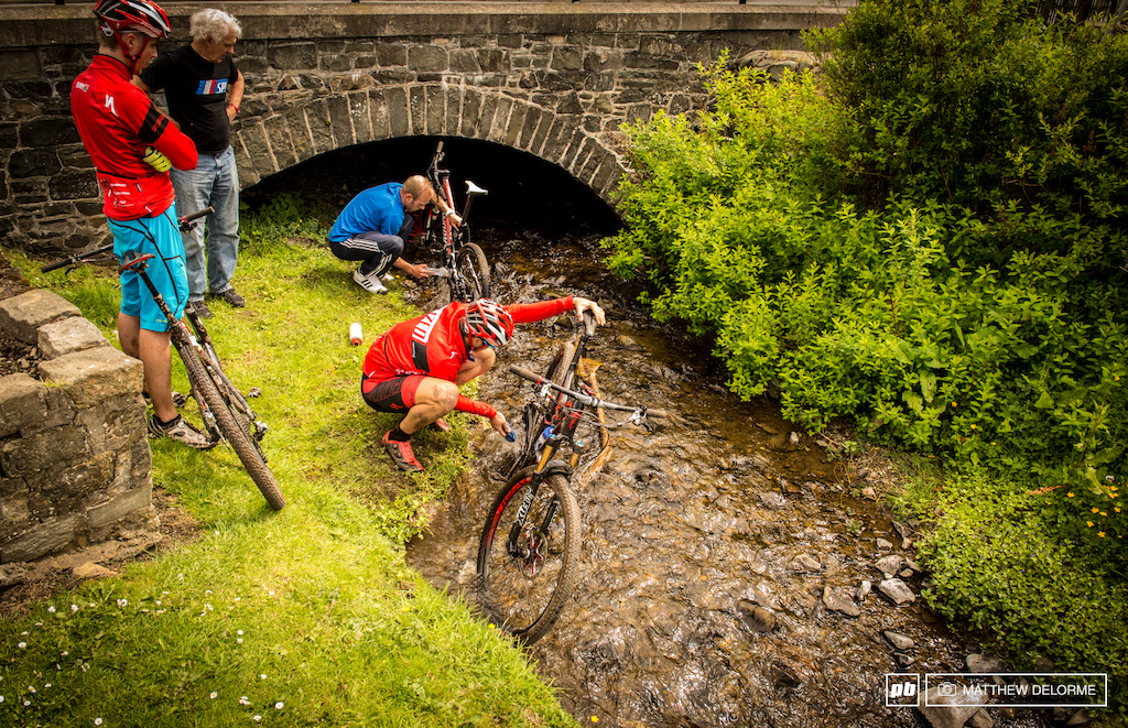 The traditional Scottish bike wash. Get em clean in the local stream.