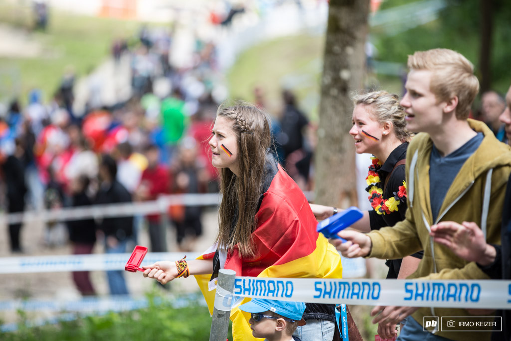 Young German spectators cheer the riders up one of Albstadt s steep climbs. With weather looking good tomorrow is poised to be an awesome spectator packed race day.