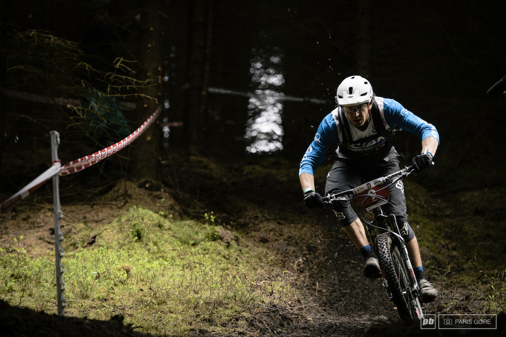Adam Craig spraying up a rooster tail of loam.