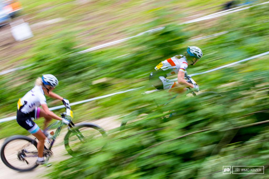 Maja Wloszczowska and Jolanda Neff push hard in an effort to catch up.