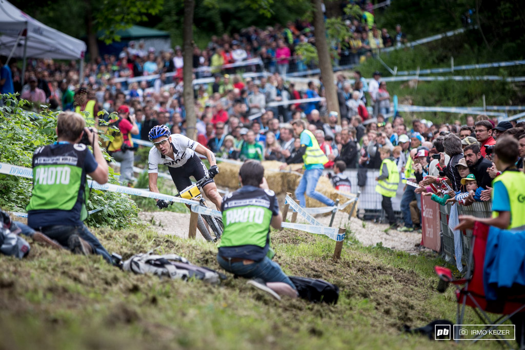 All in a World Cup game. Photographers line the course in Albstadt.