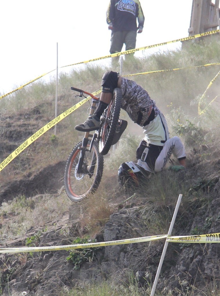 "Lost the line on a sic switchback drop...rider did a full ""Scorpion"" but was OK.  Rode down the rest of the course."
