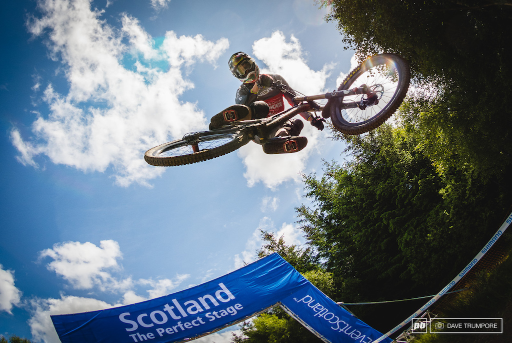 This is Greg Minnaar s 100th World Cup so he knows all too well how to throw in some style for photoraphers waiting at the final jump. Bonus points for looking right at the camera.