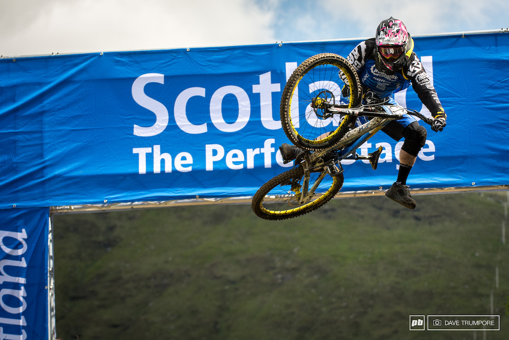 Joe Smith is one of the few flat pedal holdouts here at Fort William and he is attacking with foot out flat out style on track and in the air.