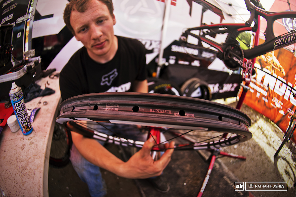 Peaty s mechanic Tom Duncan coming to the end of a week long wheel building rampage for the Syndicate. Steve and the crew are working with prototype versions of the M90- the tubeless hookless-bead carbon DH rim.