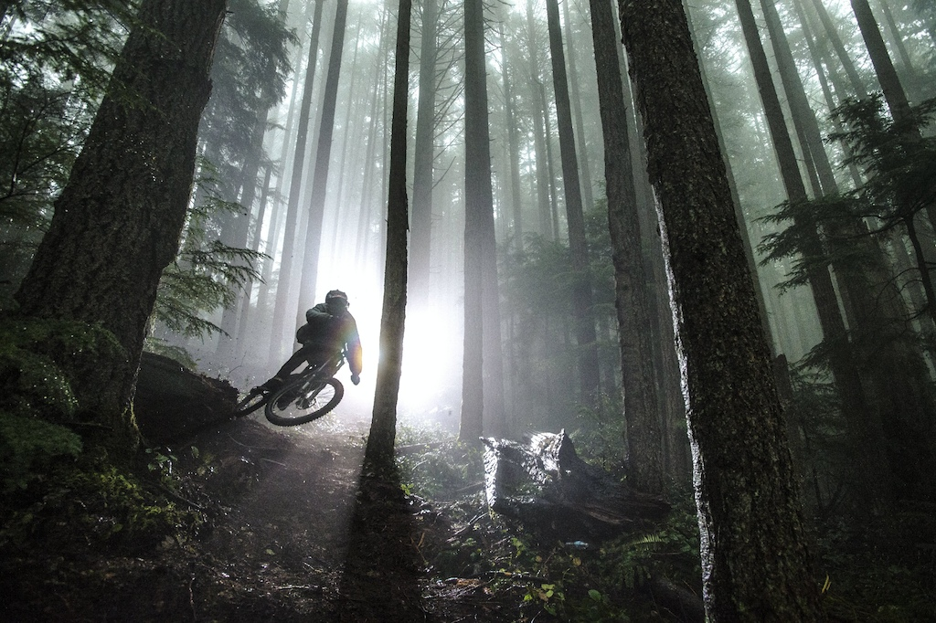 Brandon Semenuk rides a trail in the rain during the filming of Rad Company, in Sunshine Coast, BC, Canada, on 5 April, 2014. // Scott Markewitz/Red Bull Content Pool // P-20140604-00426 // Usage for editorial use only // Please go to www.redbullcontentpool.com for further information. //