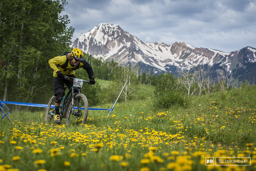 Stage one of racing sent racers into some incredibly scenic areas of Snowmass mountain. Alex Petitdemange grins as he hammers out a flat section no time to enjoy the views