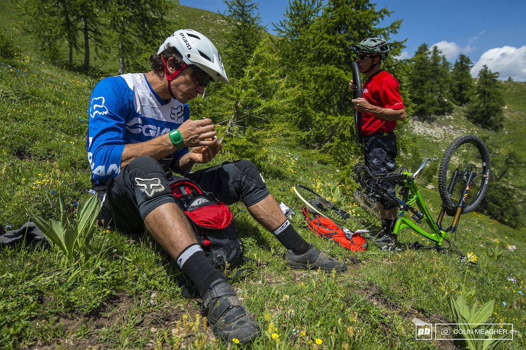 Fortunately I had plenty of Jambon to work on while Lars inflated his non-downhill Baloney Skin. -Adam Craig... One thing the trails in the Alps are never short of is sharp rocks and unexpected square edge hits. Run tubeless and carry a few spares just in case...