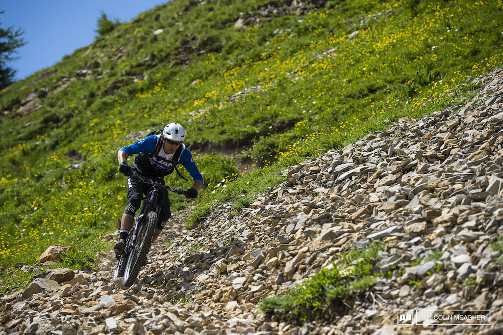 A lot of protection is compulsory in French Enduro. They ve got your back covered. Literally. Casual Tuesday might have found us a touch under-prepared... -Adam Craig rolling hot into a scree field on last year s EWS course.