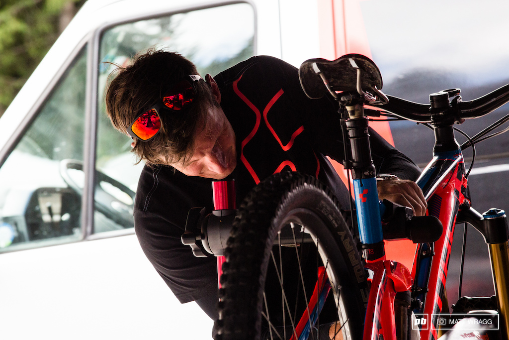 Jan prepares Nico Laus bike for action. We reckon the Frenchman is probably the man to watch this weekend as he was utterly flying last time out at Valloire.