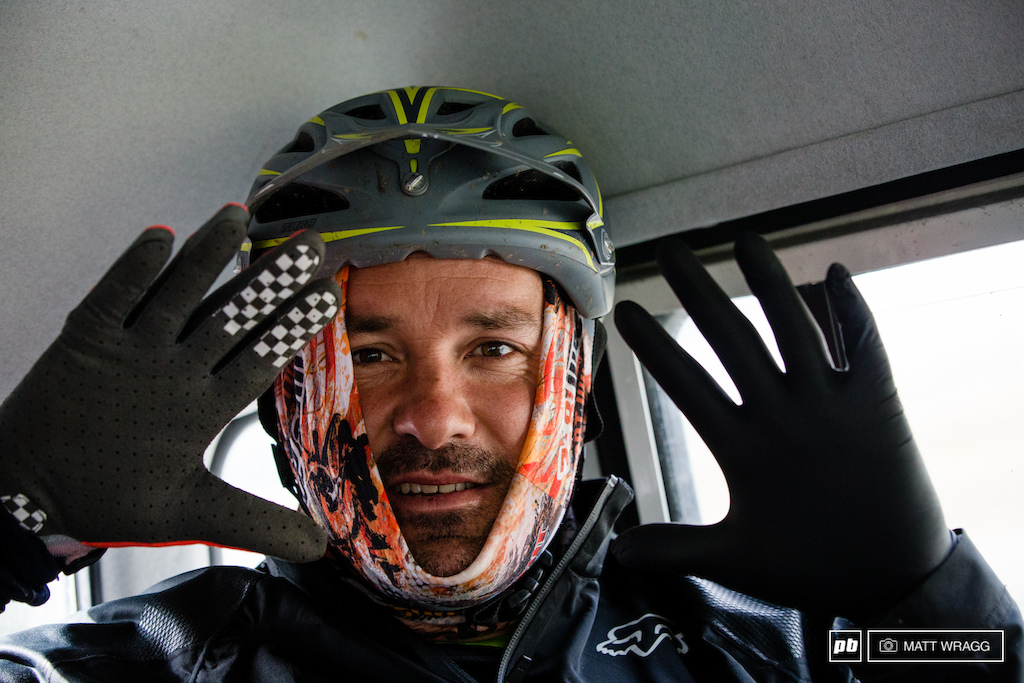 Sven Martin was prepared for shooting at 2,600m this morning: latex gloves under his riding gloves and his headgear pull in tight.