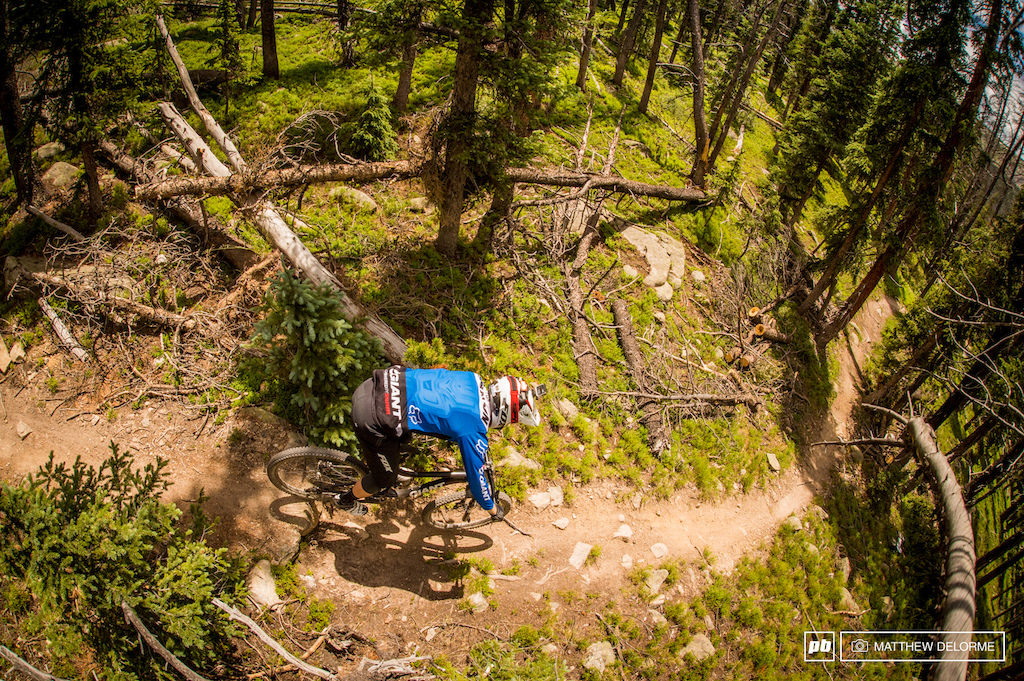 The top of stage three is covered in lush green with an amazing strand of single track that winds its way down into a game-on section that includes many rocks that love to eat low hanging bike parts by the dozen.