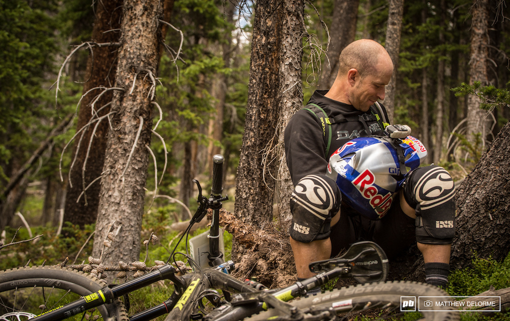 They don t call him the Wild Man for nothing. Rene Wildhaber finds a comfy spot in the woods to make some adjustments after getting a little too up close and personal with a tree.