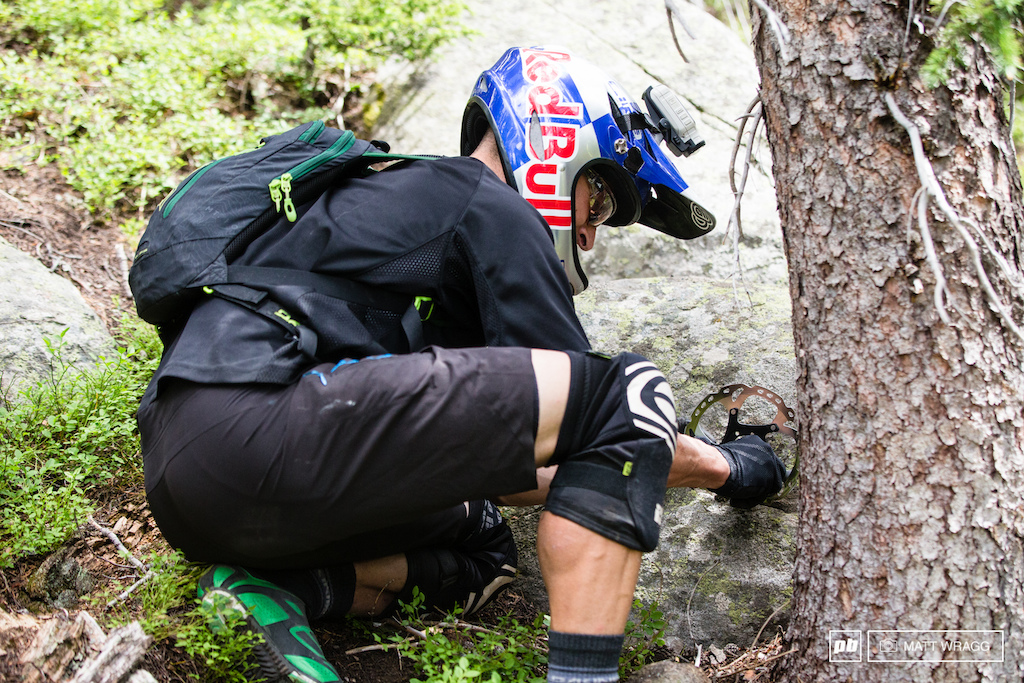 If there is a place to break it there will be a place to fix it. Rene Wildhaber is a practical man stepping in to help straighten his teammates rotor that got mangled on one of the awkward rocks on stage three.