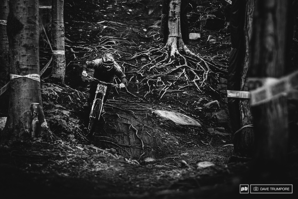 There is no room for error in the dark and slick woods that make up the bottom of the track. Many a rider has been taken out in the rocks and roots this weekend.
