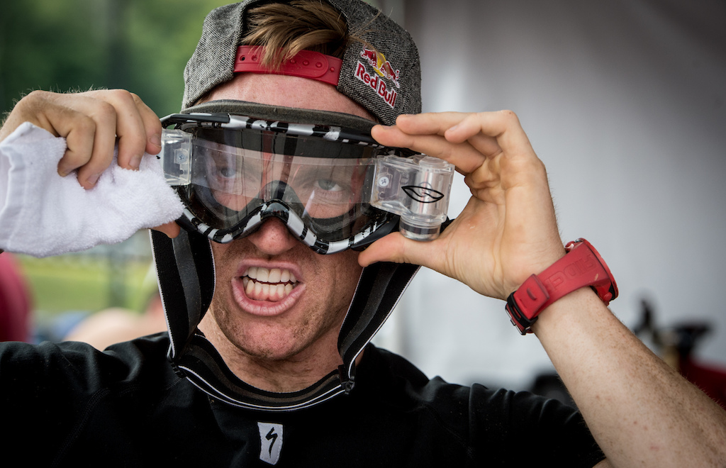 Aaron Gwin making sure he has a clean line of sight through the mud.