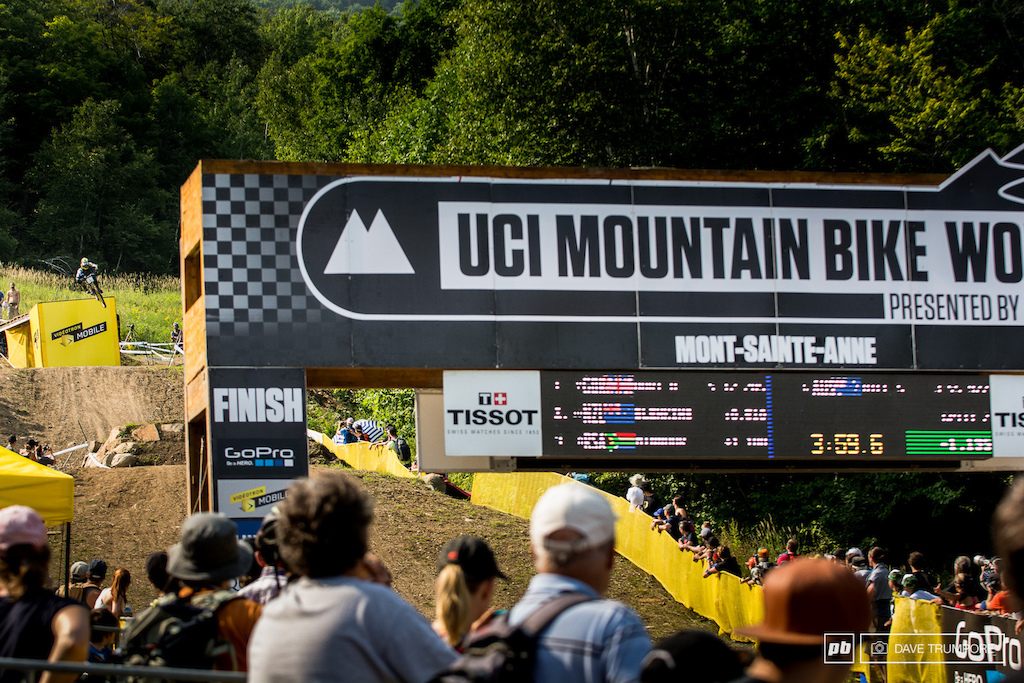 Sam hill squashes the final jump into the finish area as the timing clock in green tells the tale.