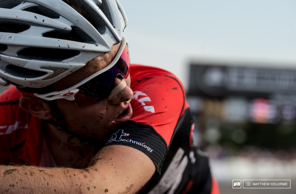 An exhausted Mathias Fluckiger takes a moment to catch his breath at the finish line. Fluckiger finished fifth today.