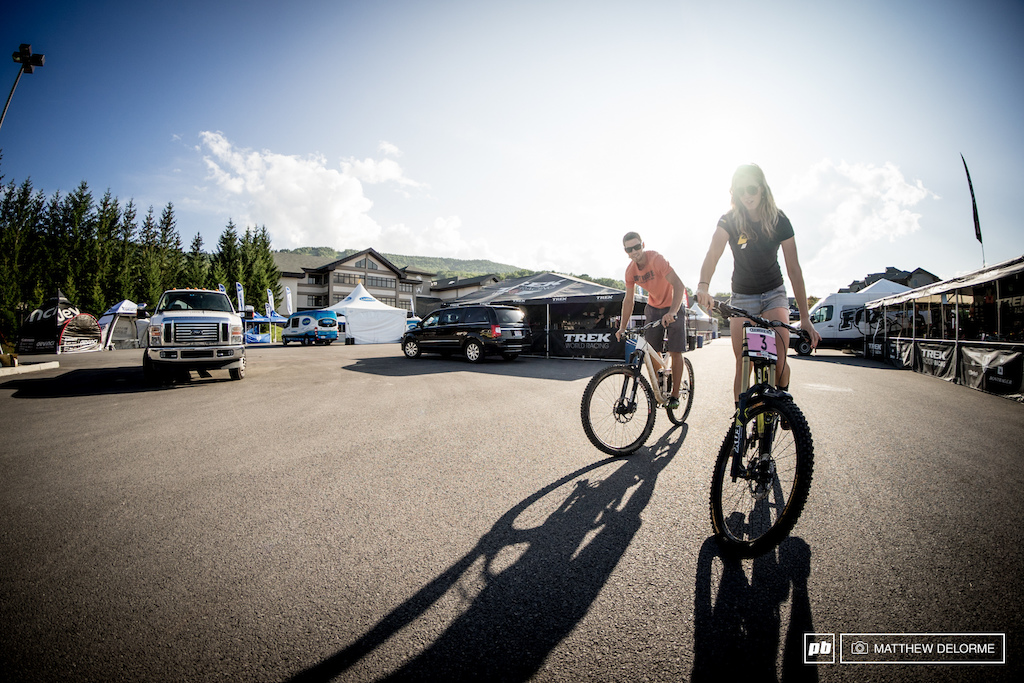 Rachel Atherton gives her bike the old parking lot compression test before practice starts tomorrow.