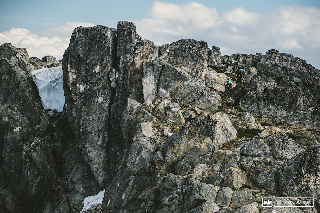 Andreas Hestler and Wade Simmons looking for lines somewhere off Whistler peak.