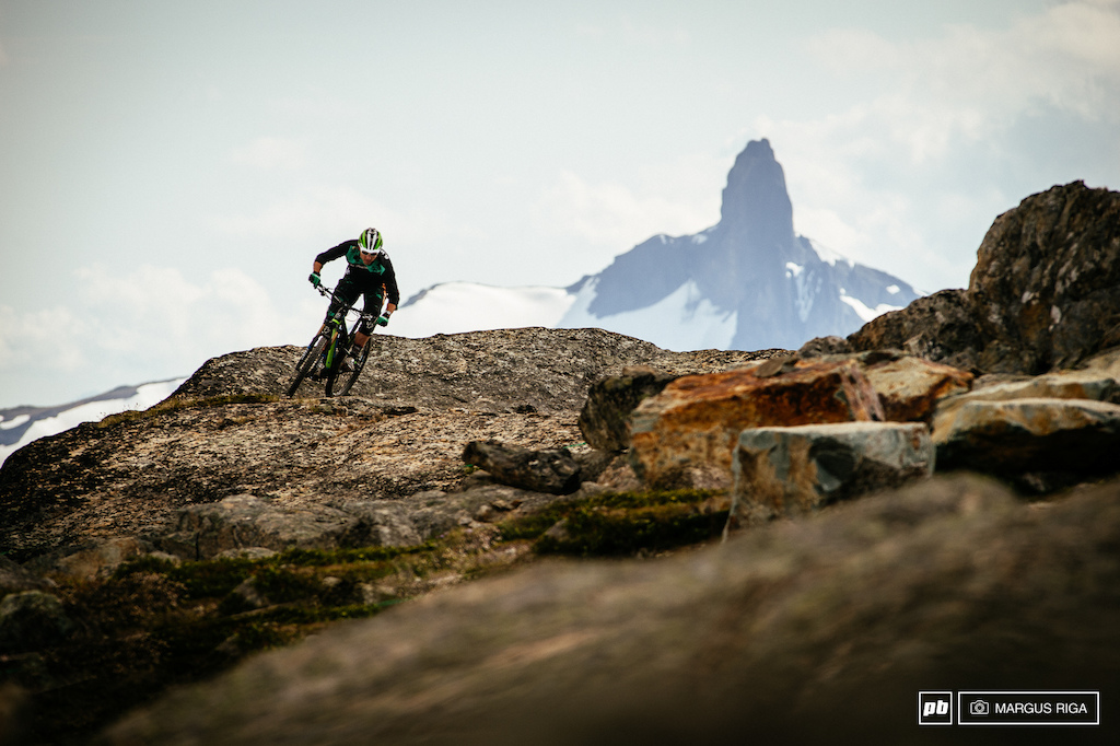 Andreas Hestler exploring Whistler peak with Black Tusk looming in the distance.