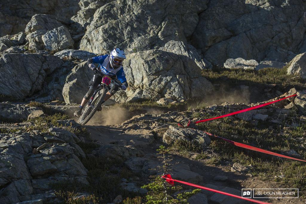 Giant s Kelli Emmett cornering hard on Top of the World.