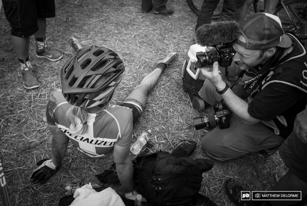 Annika Langvad took a few minutes to sit down at the end of the race and get her legs back under her.