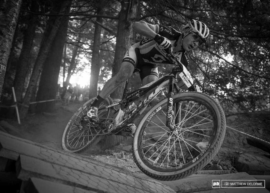 Florian Vogel hops out of the woods on the final descent to the finish line.