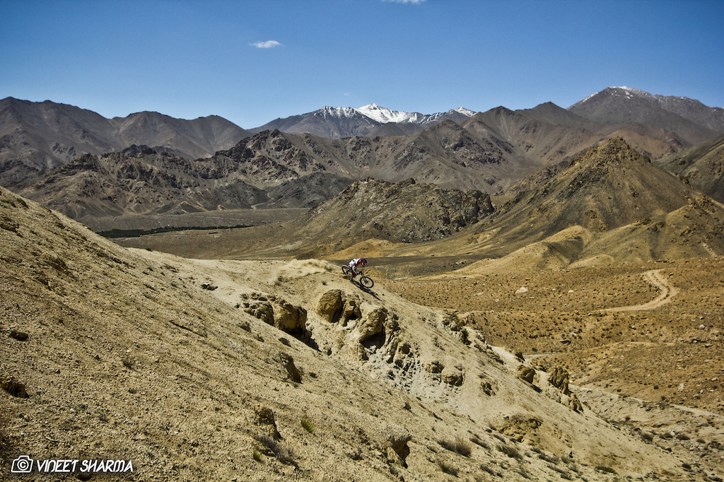 High n Dry. Guido Tschugg pinning it in one the of the most epic places to ride in the Himalayas.