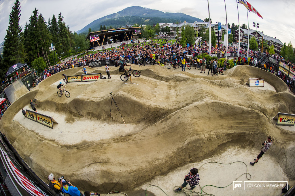 Head to head pump track action in Whistler Village during the the Crankworx 2014 Pumptrack Challenge competition. Just like dual slalom, riders got one run on each track, with the time differential determining who advances to the next round.