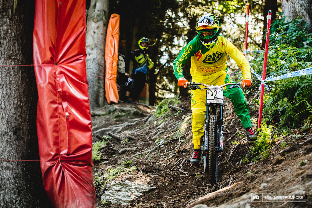 Meribel is a proper multi-line track. The main racing line is 10 feet to Troy Brosnan s right as he chooses to straighten the corners via one very rooty off camber.