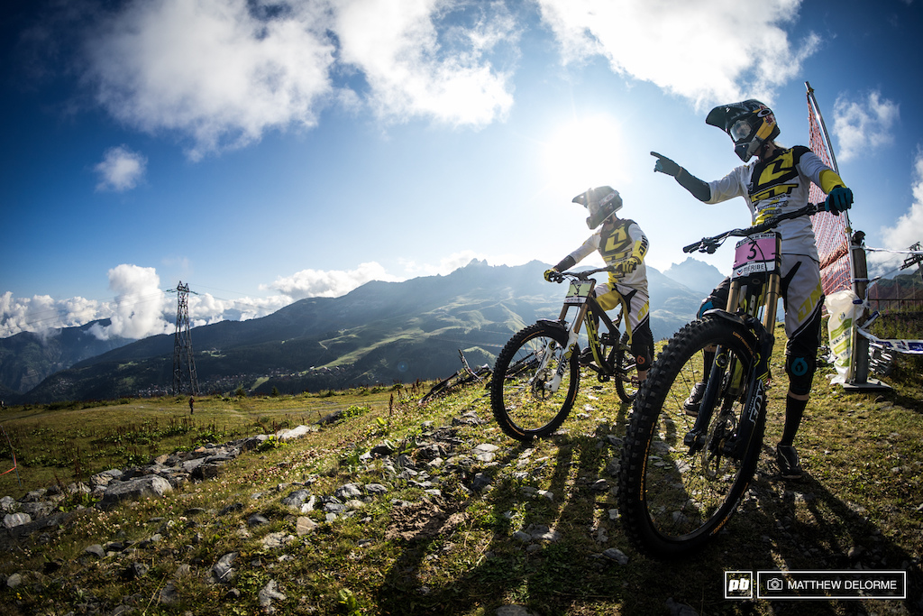 Rachel Atherton and Taylor Vernon take a quick peek down track before heading out on their first run.