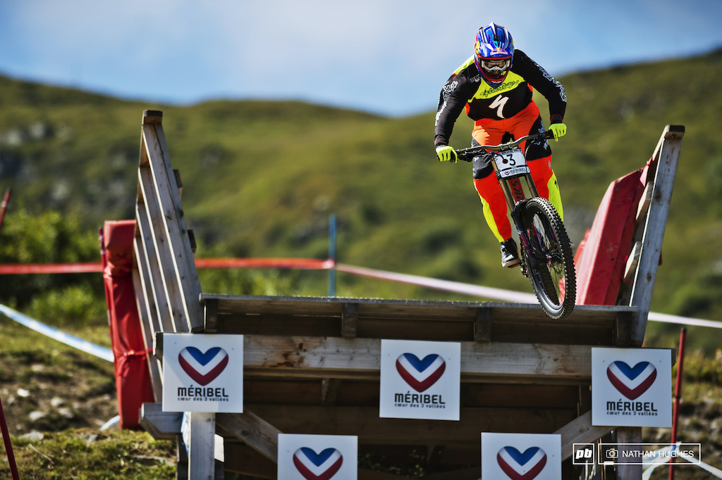 2011 & 2012 overall winner flexing his fluro muscles over the road gap.