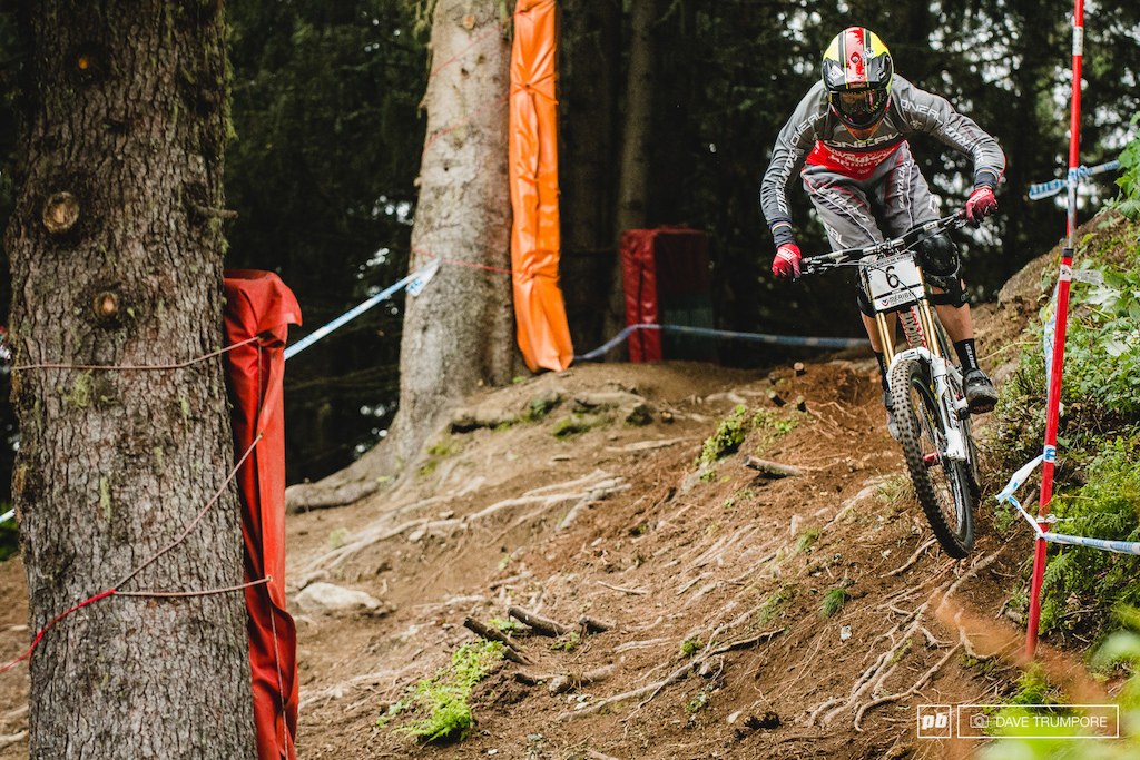 Greg Minnaar straightens out two corners by taking the tricky and risky off camber line to the inside.