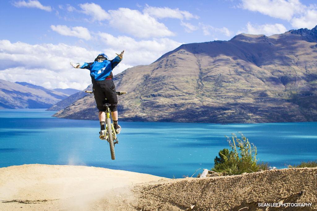 Suicide over Lake Wakatipu. The sketchy berm transfer and strong side-winds didn't phase Bernard at all.