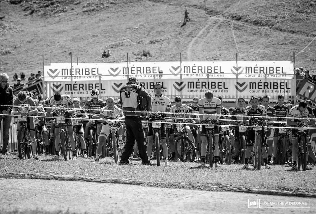 Riders observe a momnet of silence for Annefleur Kalvenaar before the start.